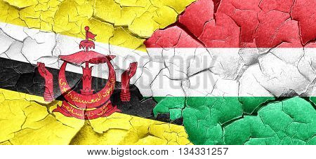 Brunei flag with Hungary flag on a grunge cracked wall