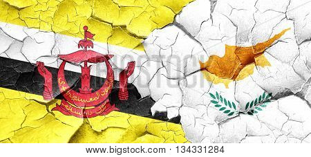 Brunei flag with Cyprus flag on a grunge cracked wall