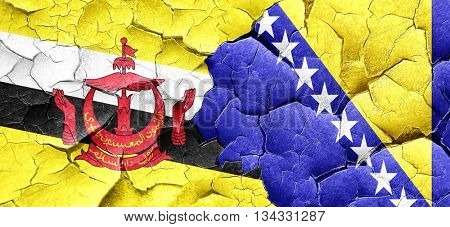 Brunei flag with Bosnia and Herzegovina flag on a grunge cracked