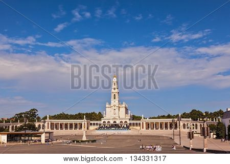 Portugal. City Fatima - Catholic pilgrimage center. The magnificent cathedral complex with colonnade, large area in front of them and  bell tower