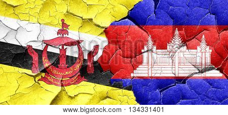 Brunei flag with Cambodia flag on a grunge cracked wall