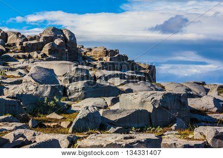 Huge stones on a plateau near falls Dettifoss. Iceland, Jokulsargljufur National Park