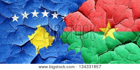 Kosovo flag with Burkina Faso flag on a grunge cracked wall