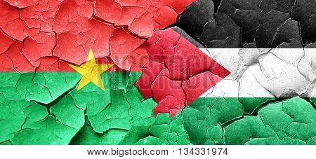 Burkina Faso flag with Palestine flag on a grunge cracked wall