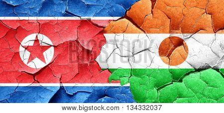 North Korea flag with Niger flag on a grunge cracked wall