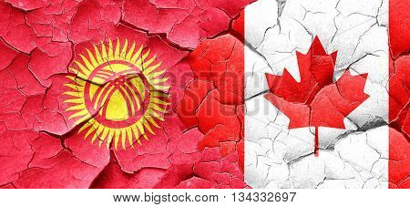 Kyrgyzstan flag with Canada flag on a grunge cracked wall
