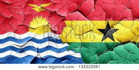 Kiribati flag with Ghana flag on a grunge cracked wall