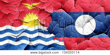 Kiribati flag with Laos flag on a grunge cracked wall