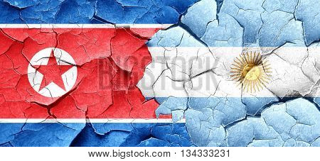 North Korea flag with Argentine flag on a grunge cracked wall