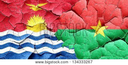 Kiribati flag with Burkina Faso flag on a grunge cracked wall