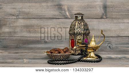 Vintage arabic lantern islamic rosary beads. Oriental holidays decoration with dates fruits