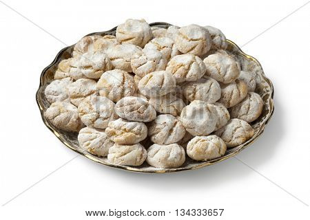 Traditional Moroccan savory coconut cookies on a dish on white background
