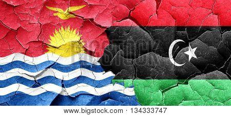 Kiribati flag with Libya flag on a grunge cracked wall