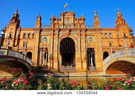 Grand Architecture Of Plaza De Espana With Flowers, Sevilla, Spain