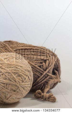 Dryer Ball and Wool Yarn with White Space in Vertical Format