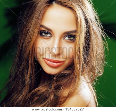 young cute blonde woman on green palm background smiling happy, lifestyle peole concept close up, beauty makeup