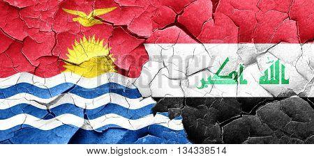 Kiribati flag with Iraq flag on a grunge cracked wall