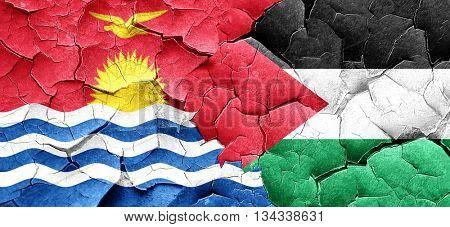 Kiribati flag with Palestine flag on a grunge cracked wall