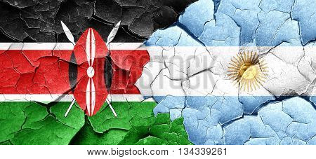 Kenya flag with Argentine flag on a grunge cracked wall