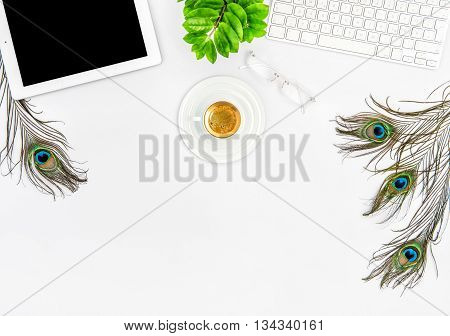 Workplace with keyboard tablet pc coffee green plant. Office desk white background