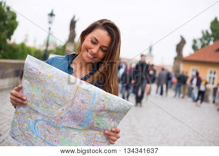 a tourist reading a map in prague