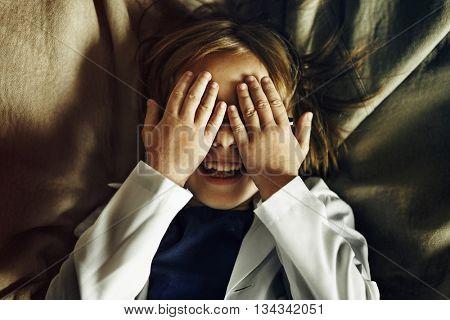 Kid Playing Hide Seek Smiling Concept
