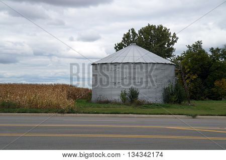 A metal silo on a farm in Joliet, Illinois during October.