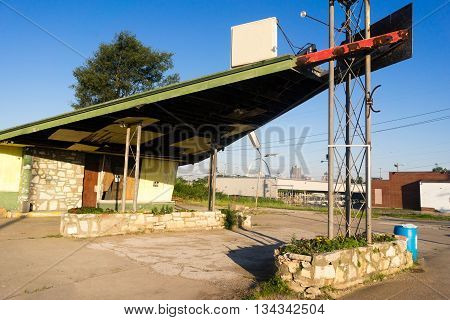 And old Gas Station withers away with no tennant in the metropolis