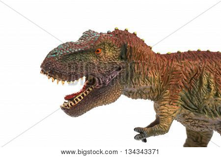 tyrannosaurus toy on a white background close up