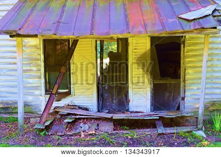 Dilapidated collapsing home which has been abandoned