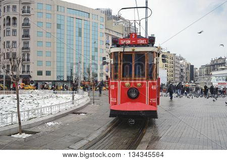 Istanbul Turkey - September 21 2012: the former tram on Istiklal Street in Istanbul Taksim-Tunel carry passengers. A cold winter day.