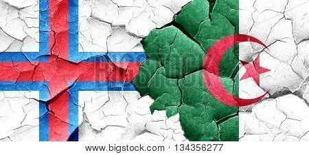 faroe islands flag with Algeria flag on a grunge cracked wall