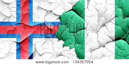 faroe islands flag with Nigeria flag on a grunge cracked wall