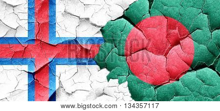 faroe islands flag with Bangladesh flag on a grunge cracked wall
