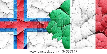 faroe islands flag with Italy flag on a grunge cracked wall