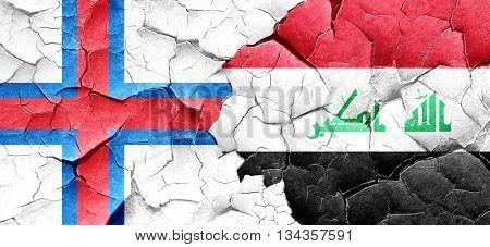 faroe islands flag with Iraq flag on a grunge cracked wall