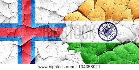 faroe islands flag with India flag on a grunge cracked wall