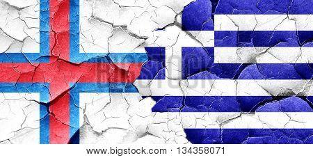 faroe islands flag with Greece flag on a grunge cracked wall