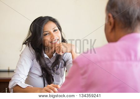 Closeup portrait patient talking good news conversation to healthcare professional isolated indoors background