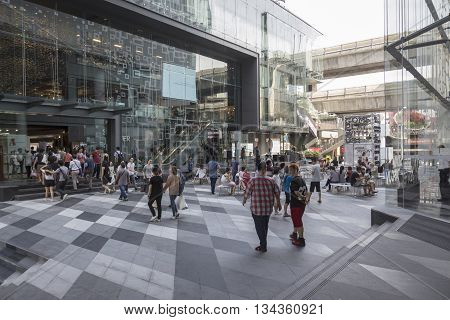 BANGKOK THAILAND - MAY 29 : crowd in open space between Siam discovery and Siam Center after renovate in siam square on may 29 2016 thailand. siam square is one of landmark for tourist in bangkok