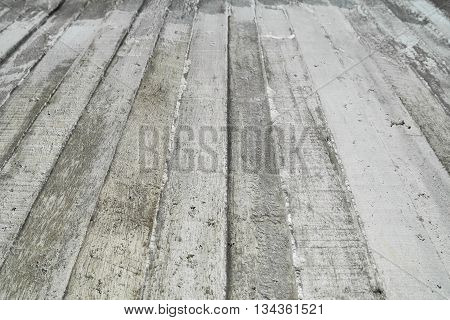 Texture Of Wooden Formwork Stamped On A Raw Concrete Wall As Background