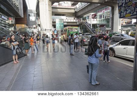 BANGKOK THAILAND - MAY 29 : unidentified people at bus stop near Siam center in siam square on may 29 2016 thailand. siam square is famous shopping place of Bangkok