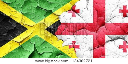 Jamaica flag with Georgia flag on a grunge cracked wall