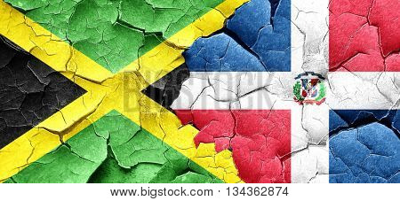 Jamaica flag with Dominican Republic flag on a grunge cracked wa