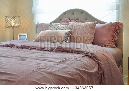 Cozy  And Classic  Bedroom Interior With Pillows And Reading Lamp On Bedside Table