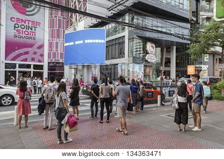 BANGKOK THAILAND - MAY 29 : group of people wait for walk across crosswalk opposite Digital Gateway at siam square on may 29 2016 thailand. siam square is famous shopping place of Bangkok