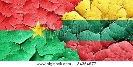 Burkina Faso flag with Lithuania flag on a grunge cracked wall