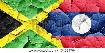 Jamaica flag with Laos flag on a grunge cracked wall