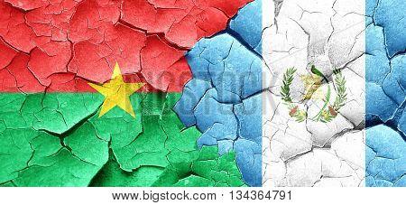 Burkina Faso flag with Guatemala flag on a grunge cracked wall