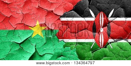 Burkina Faso flag with Kenya flag on a grunge cracked wall